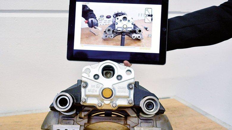 Interaktive Anleitung: Das Video zeigt, wie man einen Bremssattel repariert.