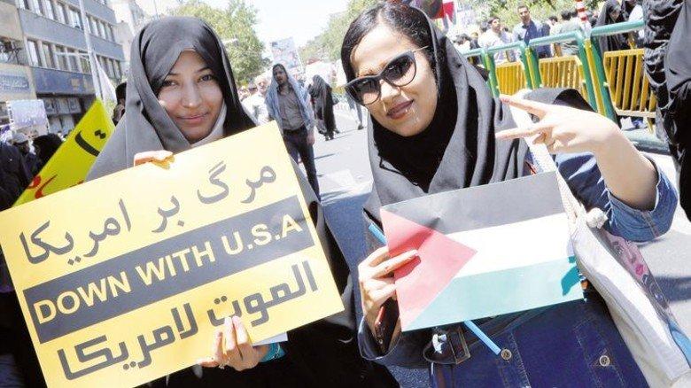 Protestmarsch in Teheran: Die Auseinandersetzung zwischen dem Iran und den USA ist auch für die deutsche Wirtschaft ein Thema. Foto: Getty