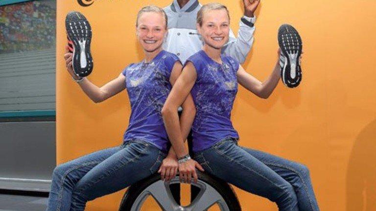 Top-Athleten als Models: Kipsang mit den Zwillingen Anna (links) und Lisa Hahner. Foto: Schaarschmidt