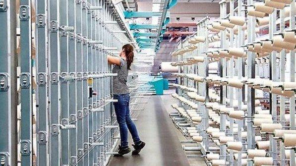 Blick ins Setex-Stammwerk: Diese Maschine bearbeitet Garnspulen. Foto: ZiTex