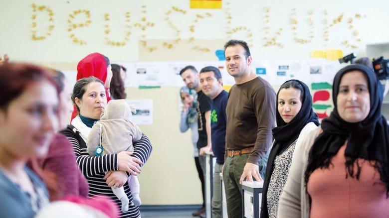 Ohne Deutsch geht es nicht: Flüchtlinge in einem Kurs. Foto: Adobe Stock