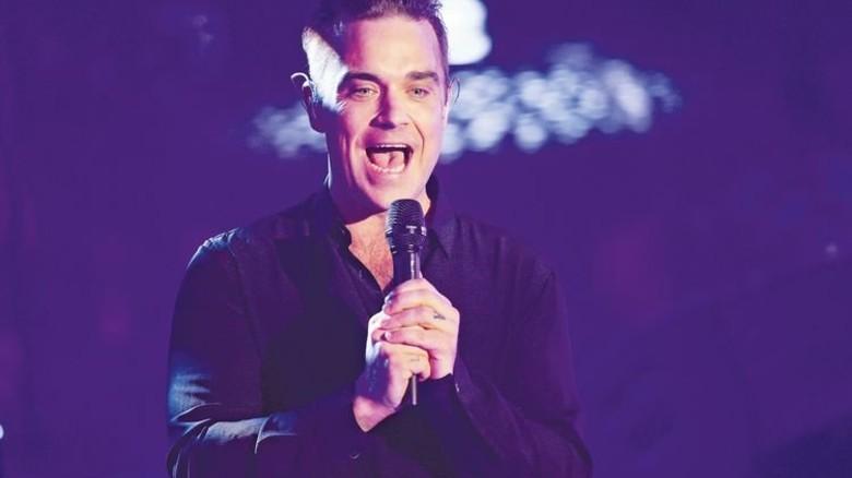 … Robbie Williams' Auftritt extrem realistisch wieder. Foto: dpa