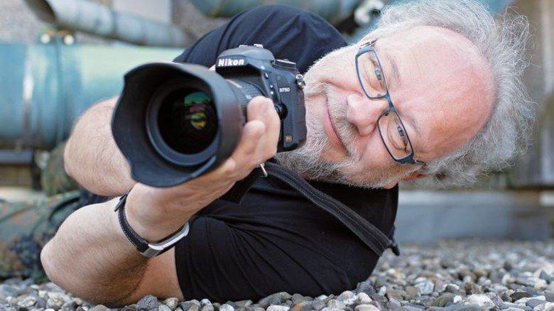 Ran ans Objekt! In seiner Freizeit ist Axel Schöps ambitionierter Fotograf. Foto: Moll