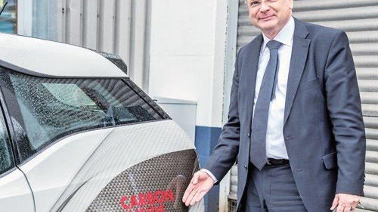 ...aber auch kleinen Autos wie dem BMWi3, den Franz-Jürgen Kümpers zeigt. Foto: Roth