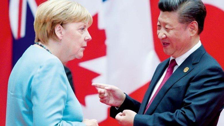 Rücken zusammen: Angela Merkel und der chinesische Präsident Xi Jinping. Foto: dpa