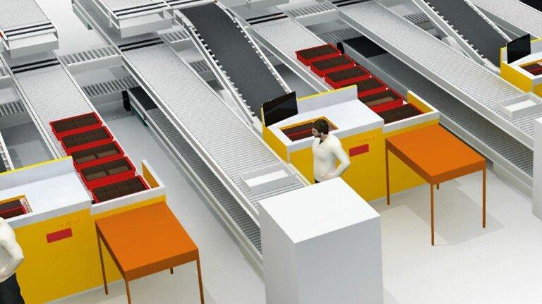 Lichtsysteme unterstützen die Mitarbeiter: An den Kommissionierplätzen werden die Waren vollautomatisch angeliefert.