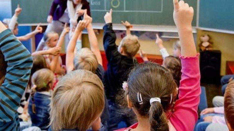 Schulklasse in Düsseldorf: NRW macht pro Schüler am wenigsten für Bildung locker. Foto: dpa