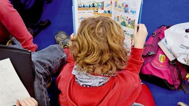 Schmökern im Comic: Die Leipziger Buchmesse zieht auch ganz junges Publikum an. Foto: Messe Leipzig