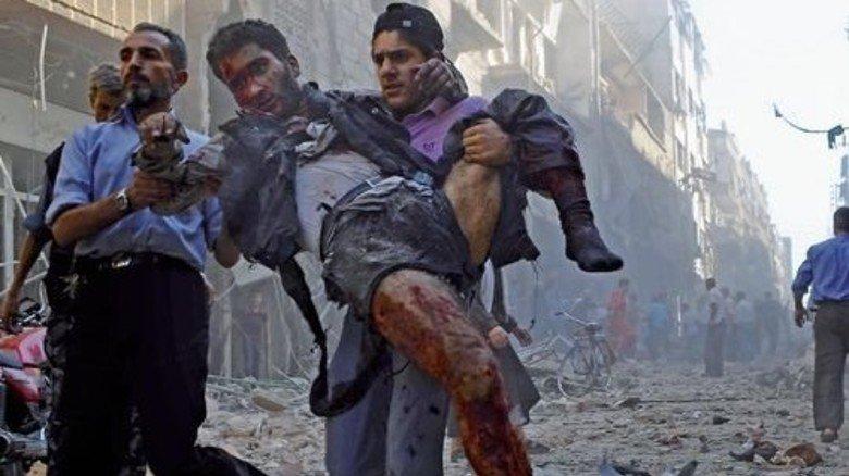 Syrien: Krieg, Terror und Tod. Verzweiflung im syrischen Damaskus. Fast ein Drittel der 2014 nach Deutschland geflohenen Menschen stammt aus dem arabischen Land. Foto: dpa