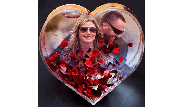 So kanns gehen: Topmodel Heidi Klum und Bodyguard Martin Kristen. Fotos: Roth, dapd